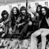 27th April 1972:  British pop rock group Uriah Heep arrive sitting on the back of a tank at the Benrather Castle in Germany to promote their current tour of the country.  (Photo by Keystone/Getty Images)